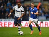 Leicester's Daniel Drinkwater and Bolton's Liam Trotter in action during the Championship match on April 22, 2014