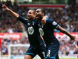 Tottenham's Danny Rose celebrates with teammate Aaron Lennon after scoring the opening goal against Stoke during the Premier League match on April 26, 2014