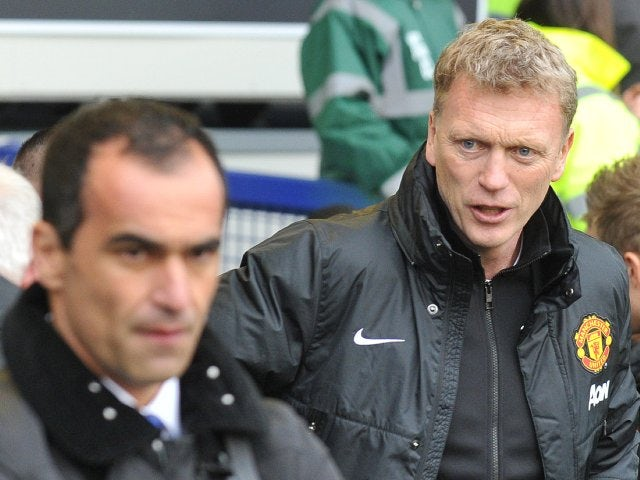 David Moyes and Roberto Martinez stand on the touchline before Everton vs. Manchester United on April 20, 2014.