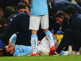 An injured David Silva of Manchester City is given treatment during the Barclays Premier League match against West Bromwich Albion on April 21, 2014