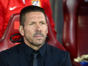 Atletico Madrid's coach Diego Simeone looks on prior to kick-off in the Champions League semi-final first leg match against Chelsea on April 22, 2014