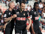 Monaco's Dimitar Berbatov celebrates with teammates after scoring the opening goal against Ajaccio during the Ligue 1 match on April 26, 2014