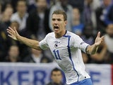 Edin Dzeko celebrates scoring for Bosnia against France on October 11, 2011.