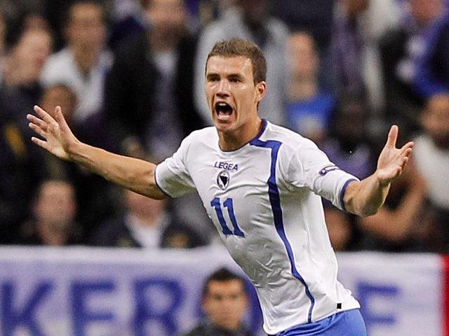 Edin Dzeko celebrates scoring for Bosnia against France on October 11, 2011.