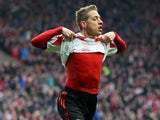 Sunderland's Emanuele Giaccherini celebrates after scoring his team's third goal against Cardiff during the Premier League match on April 27, 2014