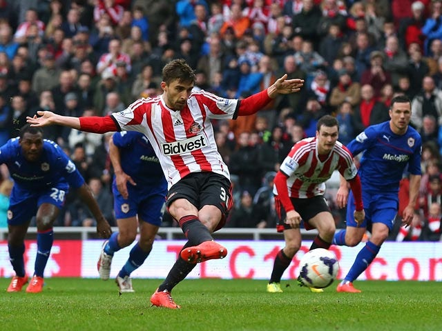 Sunderland's Fabio Borini scores his team's second goal via the penalty spot against Cardiff during the Premier League match on April 27, 2014