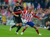 Chelsea's Fernando Torres and Atletico's Miranda in action during the Champions League semi-final first leg match on April 22, 2014