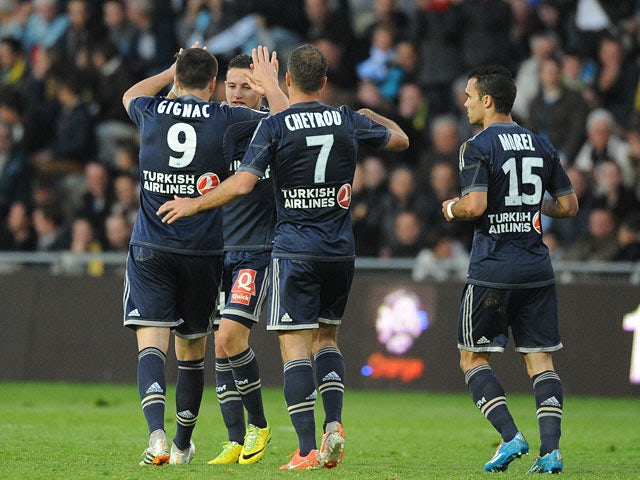 Marseille's Florian Thauvin celebrates with teammates after scoring the opening goal against Nantes during the Ligue 1 match on April 25, 2014