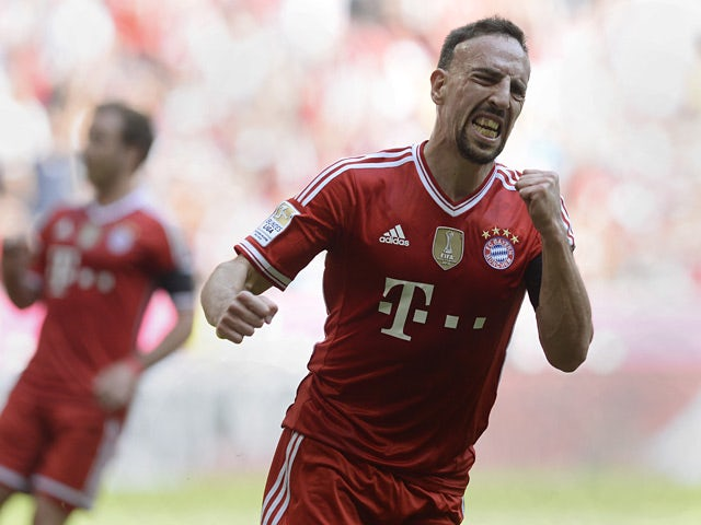 Bayern's Franck Ribery celebrates after scoring his team's first goal against Werder Bremen during their Bundesliga match on April 26, 2014