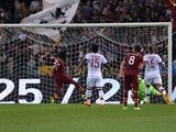Roma's Gervinho scores his team's second goal against AC Milan during the Serie A match on April 25, 2014