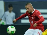 Turkey's Gokhan Tore in action against Romania during the World Cup 2014 qualifying match on September 10, 2013