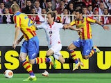 Sevilla's Croatian midfielder Ivan Rakitic (C) vies with Valencia's French defender Jeremy Mathieu (L) and Valencia's midfielder Juan Bernat during the UEFA Europa League semifinal on April 24, 2014