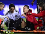 Chelsea's John Terry sits on a stretcher after picking up a foot injury during the Champions League semi-final first leg match on April 22, 2014