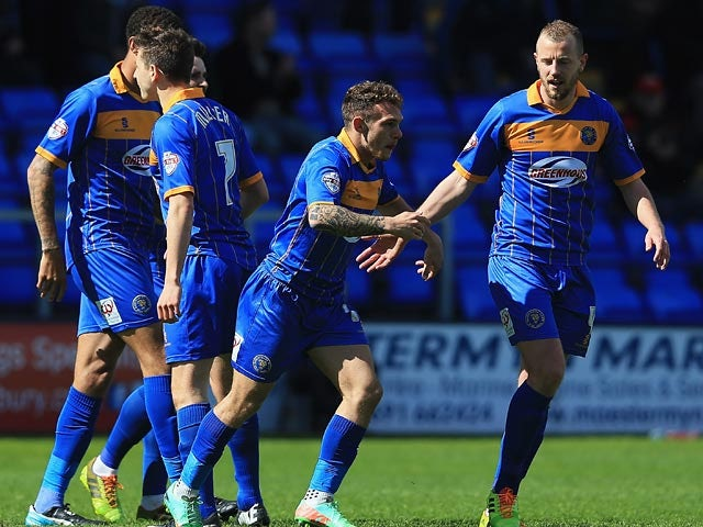 Shrewsbury's Jon Taylor celebrates with teammates after scoring his team's first goal against Peterborough during the League One match on April 26, 2014