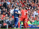 Liverpool midfielder Steven Gerrard tries to get the ball off Chelsea manager Jose Mourinho during the Premier League match at Anfield on April 27, 2014