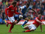 Blackburn's Joshua King is challenged by Charlton's Diego Poyet and Michael Morrison during the Championship match on April 26, 2014