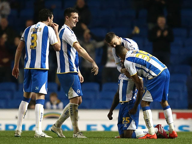 Brighton's Kazenga Lua Lua celebrates with teammates after scoring the opening goal against Yeovil during the Championship match on April 25, 2014