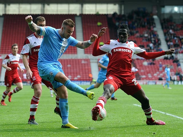 Middlesbrough's Kenneth Omeruo and Barnsley's Marcus Pederson in action during the Championship match on April 26, 2014