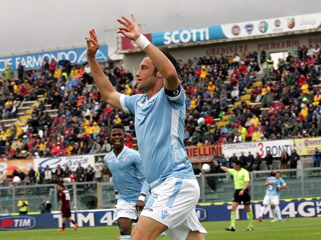 Stefano Mauri of SS Lazio celebrates after scoring a goal during the Serie A match between AS Livorno Calcio and SS Lazio at Stadio Armando Picchi on April 27, 2014