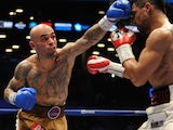 Luis Collazo punches Victor Ortiz during their WBA International Welterweight title fight at Barclays Center on January 30, 2014