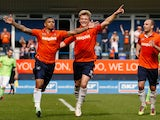 Andre Gray of Luton Town celebrates after scoring his side's first goal from the penalty spot during the Skrill Conference Premier match between Luton Town and Forest Green at Kenilworth Road on April 21, 2014