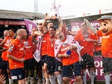 Luton Town team celebrate with the trophy following the Skrill Conference Premier match between Luton Town and Forest Green at Kenilworth Road on April 21, 2014