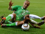 Algeria defender Madjid Bougherra performs a slide tackle against England on June 18, 2010.