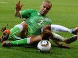 Algeria defender Madjid Bougherra performs a slide tackle against England on June 18, 2010.