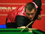 Mark Allen of Northern Ireland looks on during his match against Michael Holt of England during day four of the The Dafabet World Snooker Championship on April 22, 2014