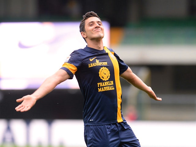 Hellas Verona's Marquinho celebrates after scoring his team's third goal against Calcio Catania during the Serie A match on April 27, 2014