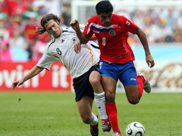 Costa Rica midfielder Mauricio Solis holds off a challenge from Torsten Frings on June 09, 2006.