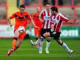 Scunthorpe's Michael Collins and Exeter's Matt Oakley in action during the League Two match on April 26, 2014