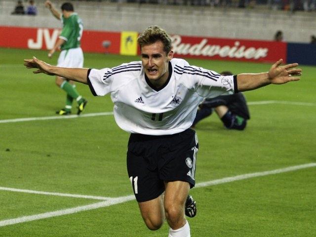 Miroslav Klose celebrates scoring for Germany against the Republic of Ireland on June 05, 2002.