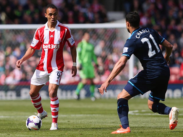 Tottenham's Nacer Chadli and Stoke's Peter Odemwingie in action during their Premier League match on April 26, 2014