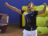 Nicolas Almagro celebrates victory over Rafa Nadal during the Barcelona Open Quarter-Finals on April 25, 2014