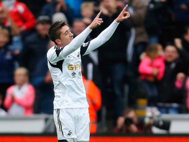 Swansea's Pablo Hernandez celebrates after scoring his team's third goal against Aston Villa during the Premier League match on April 26, 2014