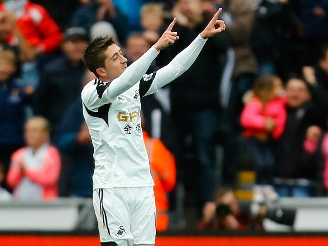 Swansea's Pablo Hernandez celebrates after scoring his team's third goal against Aston Villa during the Premier League match on April 26, 2014