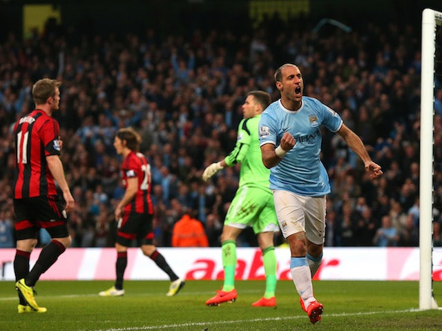 Pablo Zabaleta of Manchester City celebrates after scoring the opening goal during the Barclays Premier League match against West Bromwich Albion on April 21, 2014