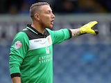 Paddy Kenny of Leeds United gestures during the Sky Bet Championship match between Leeds United and Sheffield Wednesday at Elland Road on August 17, 2013