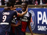 Paris Saint-Germain's French midfielder Blaise Matuidi is congratuled by teammates after scoring a goal during the French L1 football match Paris Saint-Germain (PSG) vs Evian/Thonon on April 23, 2014
