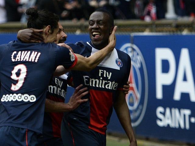 Paris Saint-Germain's French midfielder Blaise Matuidi is congratuled by teammates after scoring a goal during the French L1 football match Paris Saint-Germain (PSG) vs Evian/Thonon on April 23, 2014