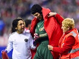 Chelsea's Petr Cech leaves the field after picking up an injury during the Champions League semi-final first leg match on April 22, 2014