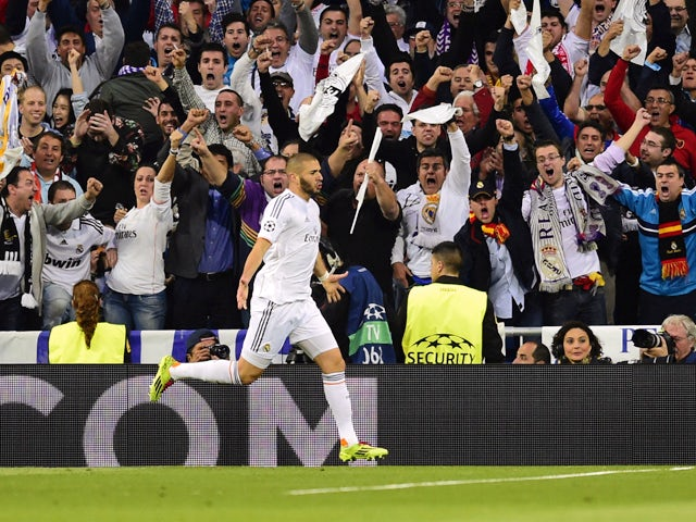 Real Madrid's French forward Karim Benzema celebrates after scoring during the UEFA Champions League semifinal first leg football match Real Madrid CF vs FC Bayern Munchen at the Santiago Bernabeu stadium in Madrid on April 23, 2014