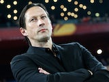Salzburg's coach Roger Schmidt looks on during his team's UEFA Europa League round of 16 first leg football match against FC Basel on March 13, 2014