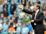 Roy Hodgson, then Fulham manager, shouts out orders to his players during their match against Manchester City on April 26, 2008.