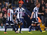 West Brom's Saido Berahino celebrates with teammates after scoring the opening goal against West Ham during the Premier League match on April 26, 2014