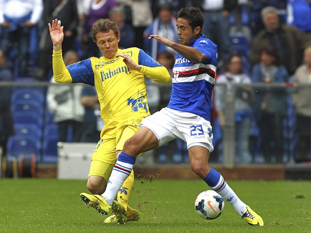 Eder Citadin Martins of UC Sampdoria competes for the ball with Nicolas Frey of AC Chievo Verona during the Serie A match between UC Sampdoria and AC Chievo Verona at Stadio Luigi Ferraris on April 27, 2014