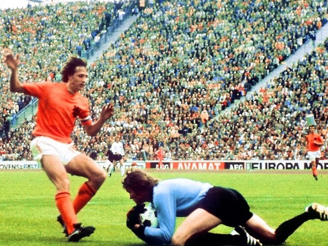 Germany goalkeeper Sepp Maier dives at the feet of Johan Cruyff on July 07, 1974.