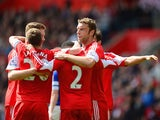 Southampton players celebrates after Everton's Seamus Coleman scored an own goal to make it 2-0 during the Premier League match on April 26, 2014