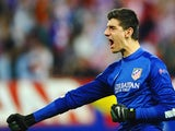 Thibaut Courtois celebrates Atletico Madrid scoring against Barcelona on April 09, 2014.